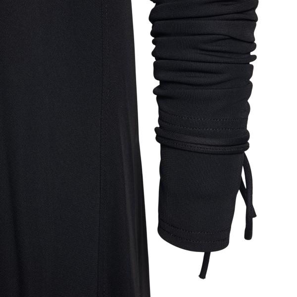 Long black dress with curl                                                                                                                             VICTORIA BECKHAM