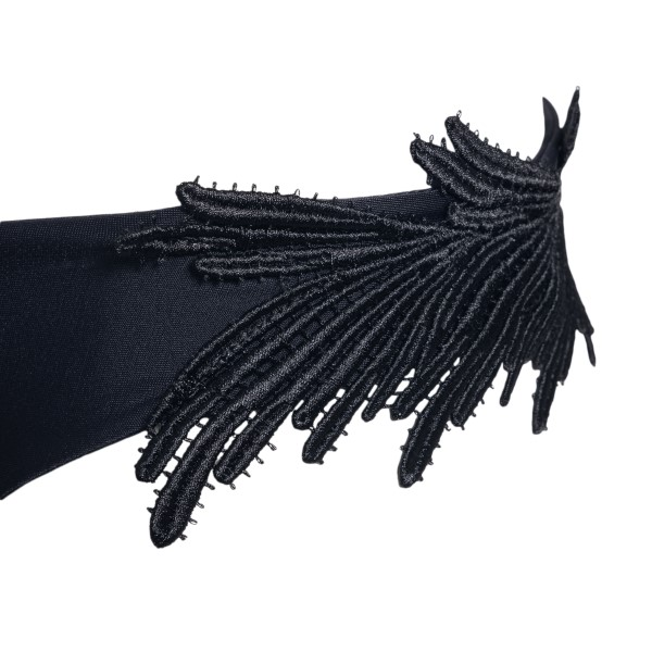Black costume with feather embroidery                                                                                                                  CLARA AESTAS