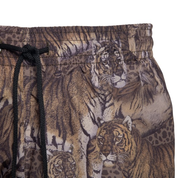 Brown costume with animal print                                                                                                                        ETRO
