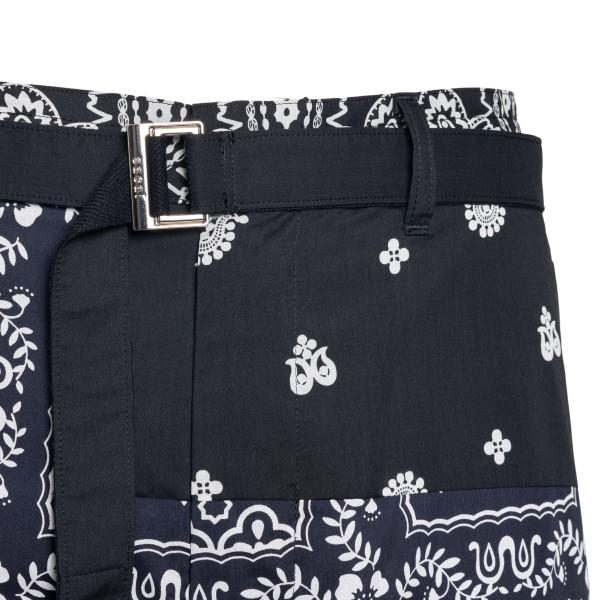 Black bermuda shorts with patterned print                                                                                                              SACAI
