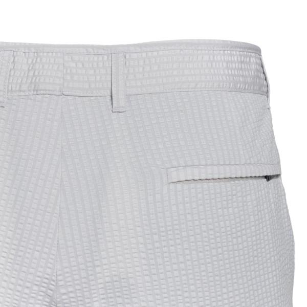 Ice-colored Bermuda shorts with pleats                                                                                                                 EMPORIO ARMANI