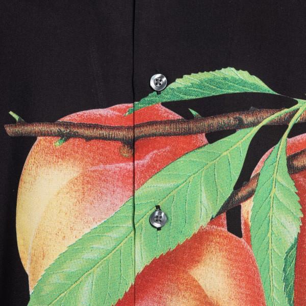 Black shirt with peach print                                                                                                                           STUSSY