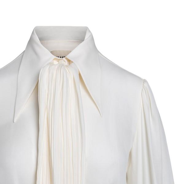Blusa bianca semitrasparente con fiocco                                                                                                                KHAITE                                             KHAITE