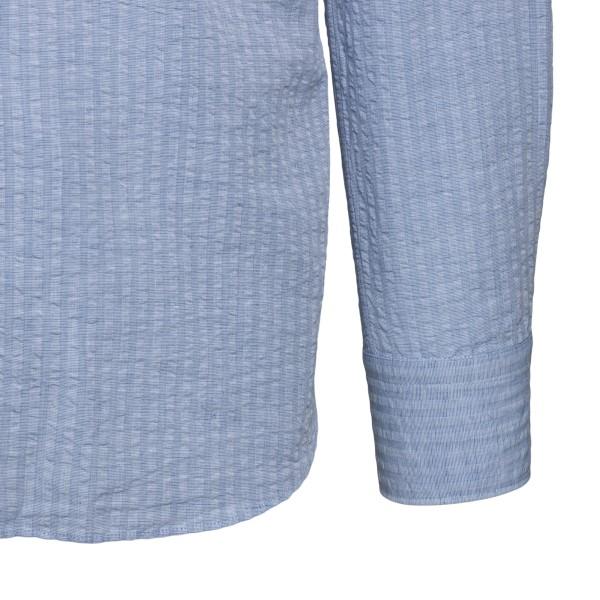 Light blue shirt                                                                                                                                       XACUS