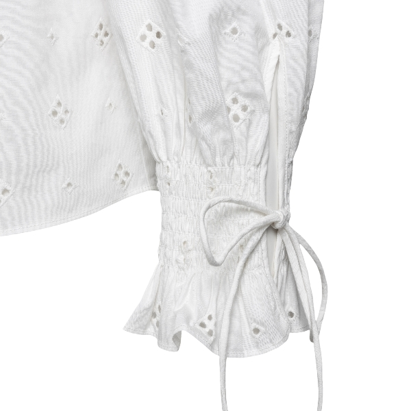 White blouse with ruffles and holes                                                                                                                    RIXO