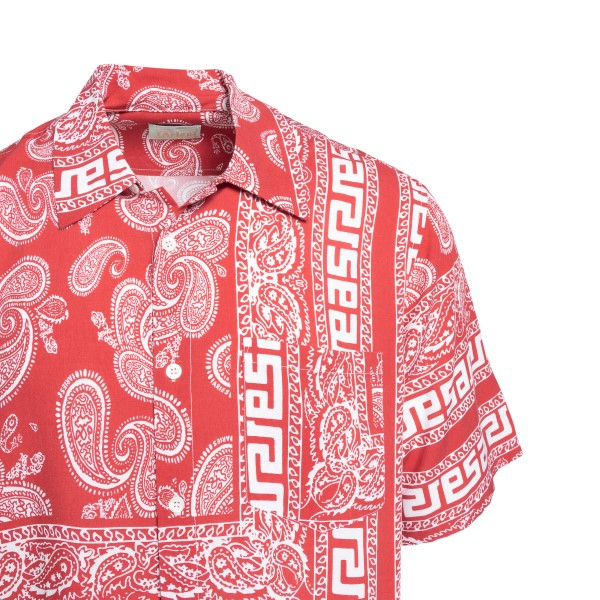 Red shirt with paisley print                                                                                                                           ARIES