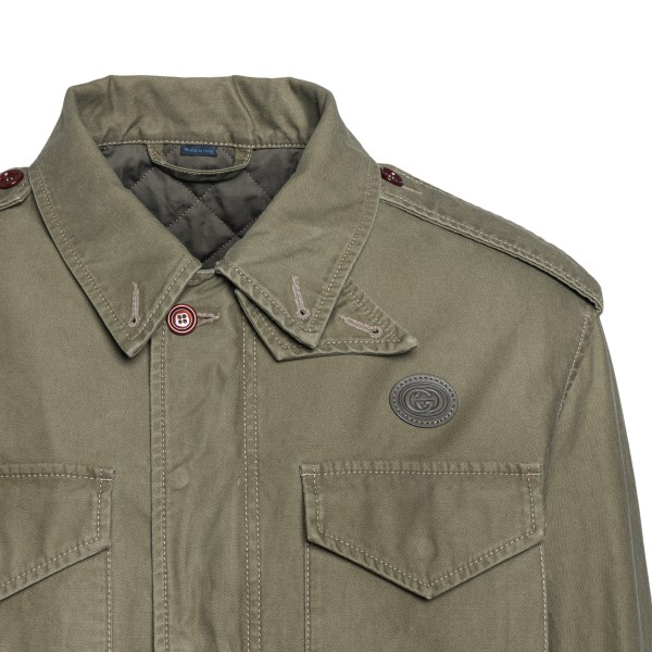 Military green jacket with Donald Duck print                                                                                                           GUCCI
