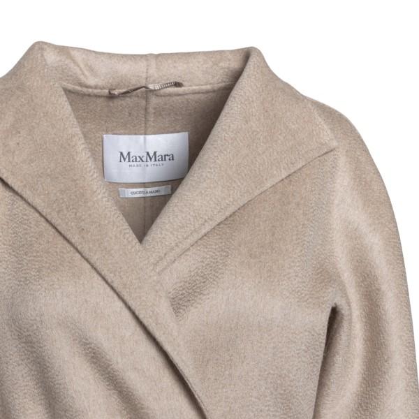 Long beige coat                                                                                                                                        MAX MARA