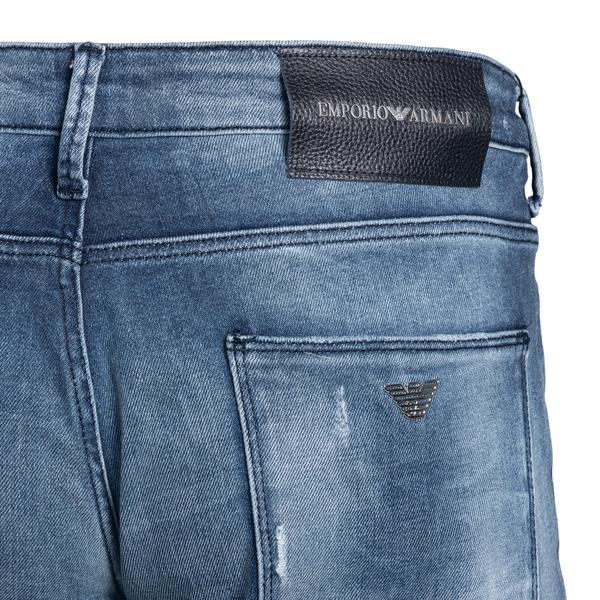 Jeans blu a effetto vissuto con strappi                                                                                                                EMPORIO ARMANI EMPORIO ARMANI