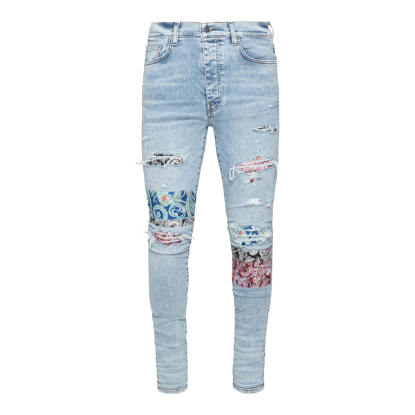 Light blue skinny jeans with patterned patche                                                                                                          AMIRI