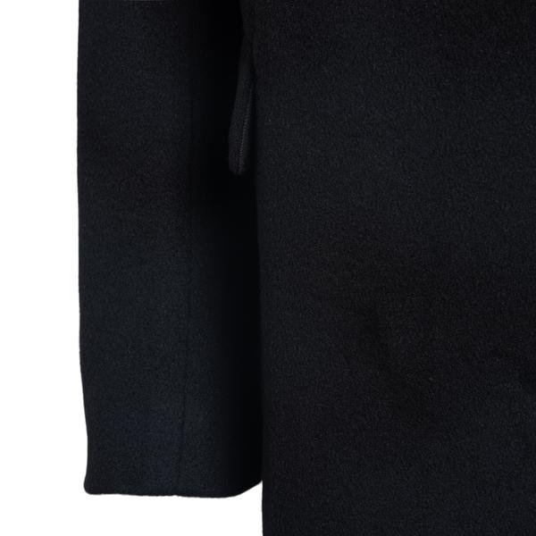 Long black coat with tassel                                                                                                                            ANN DEMEULEMEESTER