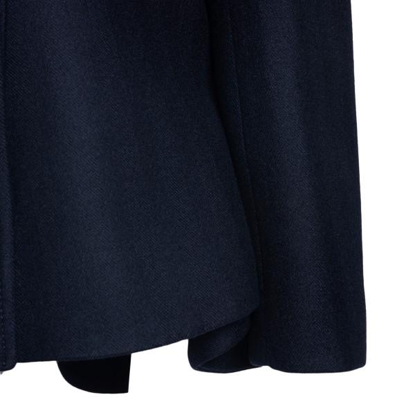 Blue coat with flared waist                                                                                                                            ALEXANDER MCQUEEN