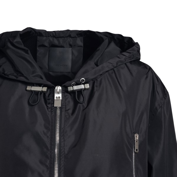 Black jacket with brand name on the back                                                                                                               GIVENCHY