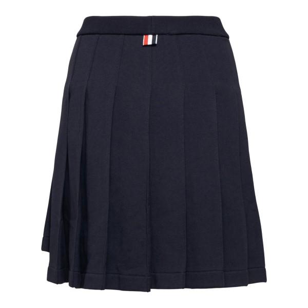 Blue pleated skirt                                                                                                                                     THOM BROWNE