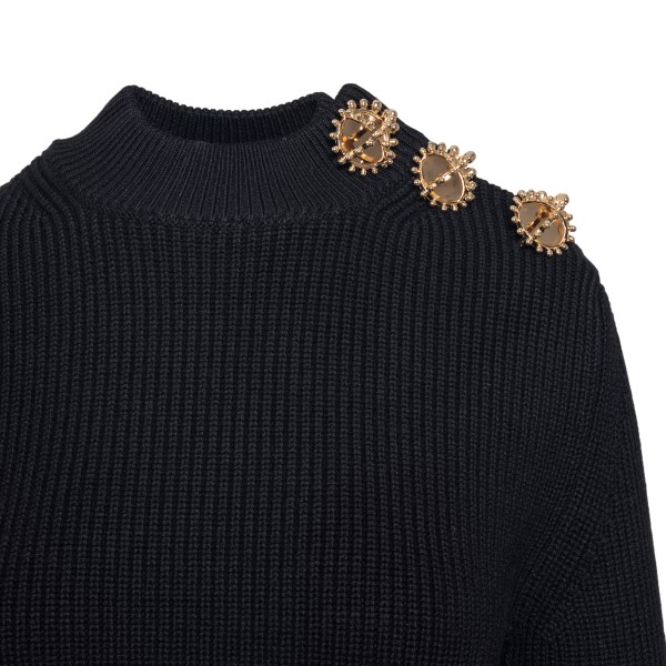 Black ribbed top with gold brooches                                                                                                                    PATOU