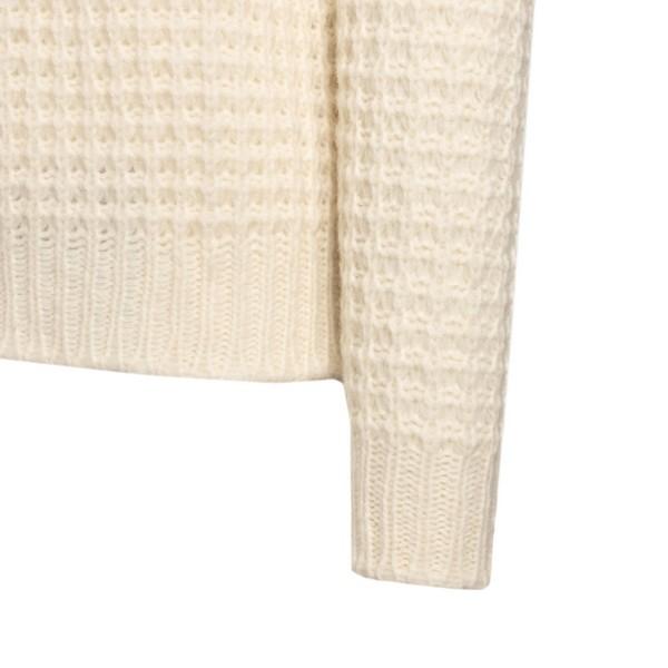 White knitted turtlenecks                                                                                                                              ROBERTO COLLINA