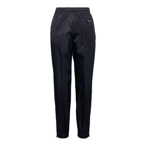 Black track pants with logo plaque                                                                                                                    Prada 22H844 front