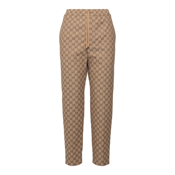 Beige track pants with logo pattern                                                                                                                   Gucci 569769 back