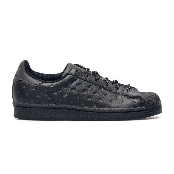 Black sneakers with triangles decoration                                                                                                              Adidas energy pack GY4981 front