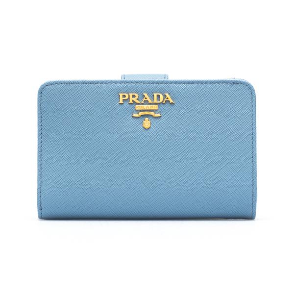 Portafoglio azzurro con bottone                                                                                                                       Prada 1ML225 retro